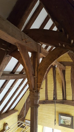 Traditional framed roof using mortises and tenons and timber pins to hold the building together. Built by Rob Hadden